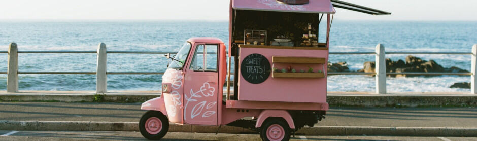pink food truck by the sea