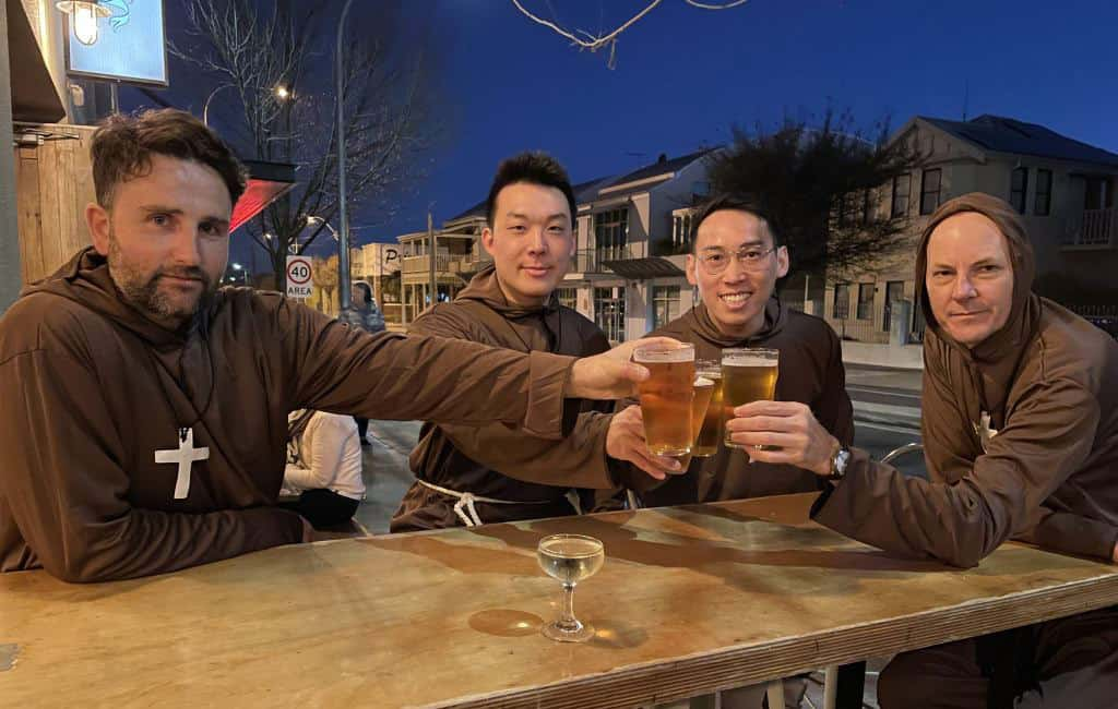 4 monks drinking beer
